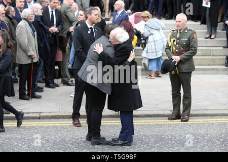 Belfast, County Antrim, Northern Ireland, 24th April, 2019 - Irish President Michael D. Higgins hugs Sara Canning, partner of Ms Lyra McKee, after Ms McKee's funeral at St Anne's Cathedral, Donegall Street, Belfast. Ms McKee,a Journalists, 29, was shot in the head on Thursday night while observing rioting in Londonderry's Creggan estate. The New IRA has admitted responsibility for the murder of journalist Lyra McKee. Paul McErlane/Alamy Live News - Stock Photo