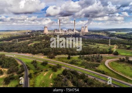 Bayswater power plant in Australian Upper Hunter Valley generating electricity from fossil fuel black coal emitting carbon dioxide into atmosphere on  - Stock Photo