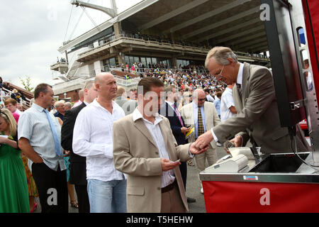 Punters at Goodwood racecourse. 29.7.2010. - Stock Photo