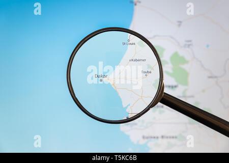 Dakar, Senegal. Political map. City visualization illustrative concept on display screen through magnifying glass. - Stock Photo