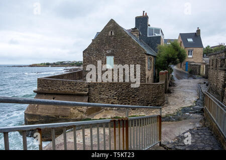 Le Becquet, France - August 16, 2018: Traditional stone house on the shores of English Channel in Le Becquet de Tourlaville. Manche , Normandy, France - Stock Photo