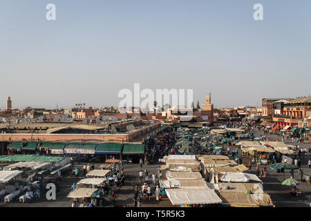 FEZ, MOROCCO - November 4, 2012: Jamaa el Fna market square after during daytime, Marrakesh, Morocco, north Africa. Jemaa el-Fnaa, Djema el-Fna or Dje - Stock Photo