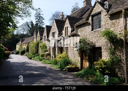 View of a row of Cotswold Stone cottages in Castle Coombe The Cotswolds Wiltshire England - Stock Photo