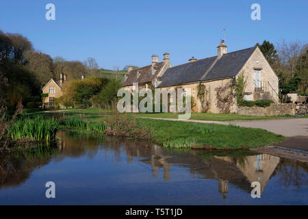 View of the River Eye in Upper Slaughter in the Cotswolds England - Stock Photo