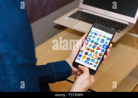 SAN FRANCISCO, US - 22 April 2019: Close up to female hands holding smartphone using Google Services and Applications, San Francisco, California, USA - Stock Photo