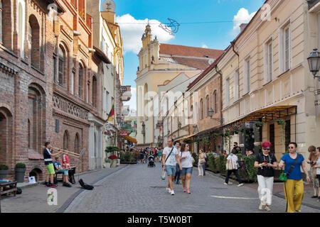 Vilnius, Lithuania - April 16, 2019 , People on the Pilies gatve street, old town - Stock Photo