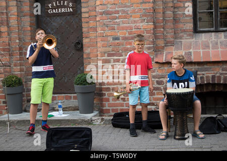 Vilnius, Lithuania - April 16, 2019, Children's music band playing on the Pilies gatve street, old town - Stock Photo