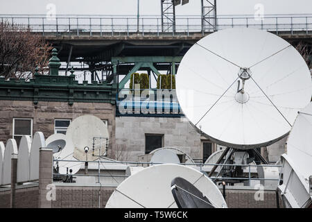 Various satellite dishes and emitters in the technical hub of a media television and radio broadcaster in the suburbs of Montreal, Quebec, Canada  Pic - Stock Photo
