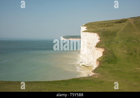 A view looking towards the Seven sisters chalk cliffs on the popular South Downs Way East Sussex England UK - Stock Photo