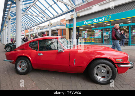 Red 1973 Triumph car on display in Farnborough town centre, part of the Farnborough Classic Car Show during April 2019, Hampshire, UK - Stock Photo