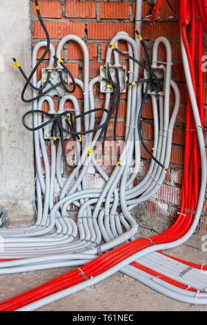 Soldered junction boxes with wires hidden in the corrugation. Realistic - Stock Photo