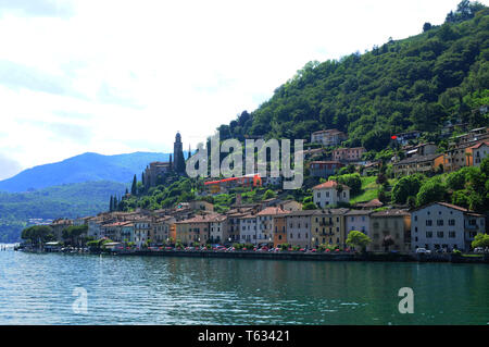 South Switzerland: Morcote at Lake Lugano in Ticino from the cruiseship seen. - Stock Photo