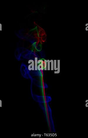 Multicolored Smoke Isolated on Black - Stock Photo