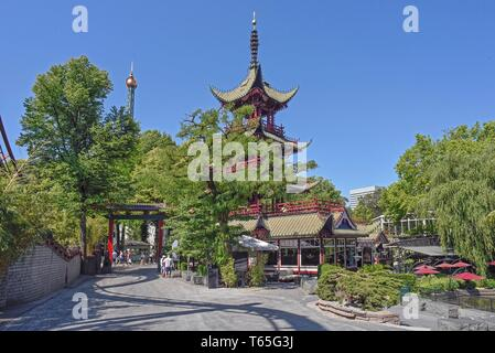 Denmark, Copenhagen, Tivoli Gardens (or simply Tivoli) is an amusement park and pleasure garden in Copenhagen, Denmark. The park opened on 15 August 1 - Stock Photo