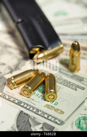 bullet on US dollar banknotes - Stock Photo
