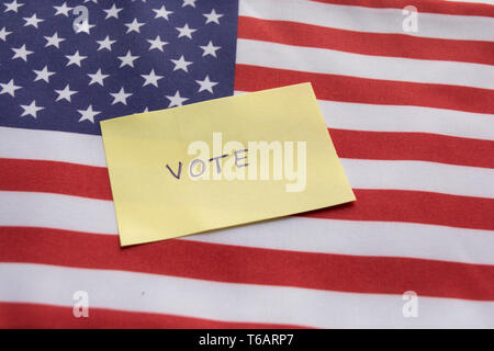Concept of US election, Vote sticker on US flag - Stock Photo