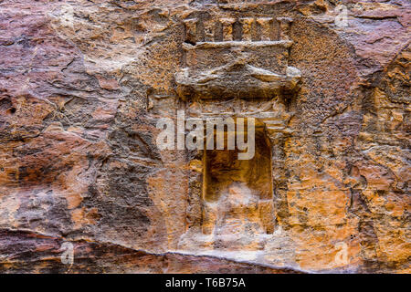 Bas-Relief  in Al-Siq is the Main Entrance Canyon to Petra, Jordan. - Stock Photo