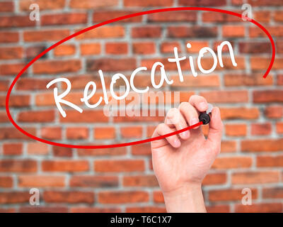 Man Hand writing Relocation  with black marker on visual screen - Stock Photo
