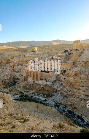 Palestine, West Bank, Bethlehem Governorate, Al-Ubeidiya. Mar Saba monastery, built into the cliffs of the Kidron Valley in the Judean Desert. - Stock Photo