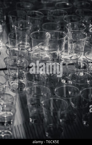 macro shot of plastic cups for degustation standing on a table, switzerland - Stock Photo