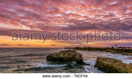 Stunning Sunset over Natural Bridges State Beach. - Stock Photo