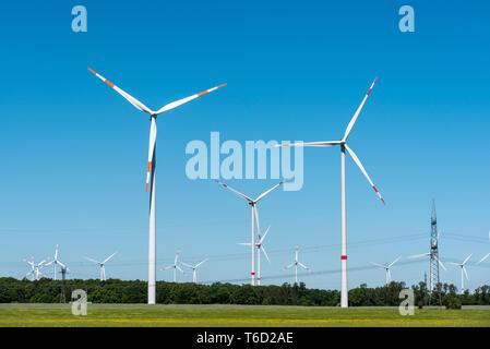 Wind generation plants seen in rural Germany - Stock Photo