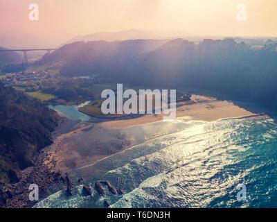 Aerial view of the ocean and rocky coast. Playa de San Pedro. Asturias, Spain - Stock Photo
