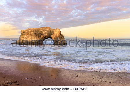 Sunset over the last remaining natural arch. - Stock Photo