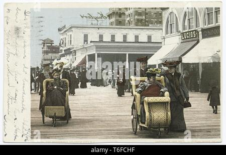 Detroit Publishing Company vintage postcard reproduction of the crowded Boardwalk in Atlantic City, New Jersey, 1905. From the New York Public Library. () - Stock Photo