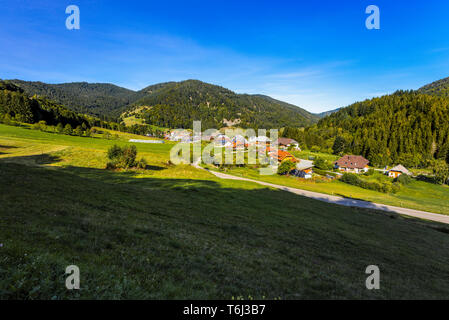 glacial cirque of the village Präg, Germany, southern Black Forest, rural landscape with hamlet, lush green meadows and surrounding mountain range - Stock Photo