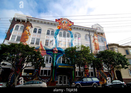 San Francisco, California, USA - 21st May 2015 : Front view of the Women's building with his decorated facade in Mission District in San Francisco, US - Stock Photo