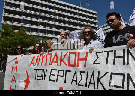 Athens, Greece. 1st May 2019. Former Greek Finance Minister Yanis Varoufakis (3rd R)  marches in front of the Ministry of Finance during a rally to mark May Day in Athens, Greece. Credit: Nicolas Koutsokostas/Alamy Stock Photo. - Stock Photo