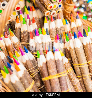 Bunches of multicolored pencils in a basket - Stock Photo