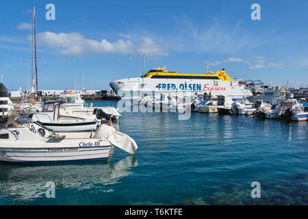 Playa Blanca, Lanzarote, Spain: April 25, 2019: Canary Island Ferry Fred Olsen Express in the harbor of Playa Blanca. It sails between Playa Blanca La - Stock Photo