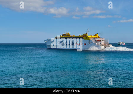 Playa Blanca, Lanzarote, Spain: April 25, 2019: Canary Island Ferry Fred Olsen Express sails between Playa Blanca Lanzarote and Corralejo Fuerteventur - Stock Photo