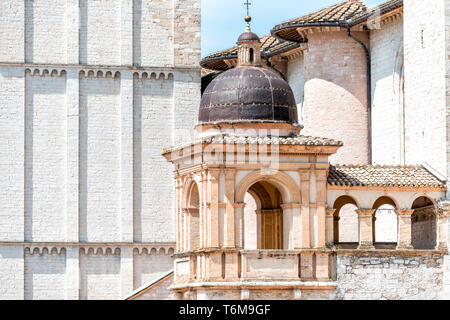 Papal Basilica of Saint Francis of Assisi church in Italy with cathedral facade and closeup of small bell tower with nobody - Stock Photo