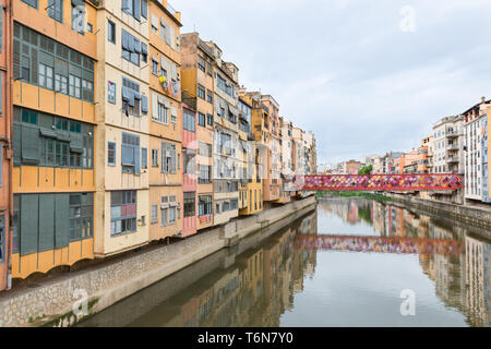 View Girona with colorful houses reflected in water, Spain - Stock Photo