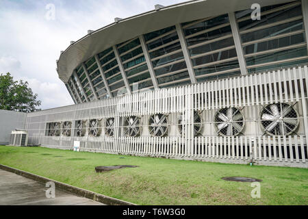 a lot of big Air Compressors in the row, of large convention hall. - Stock Photo