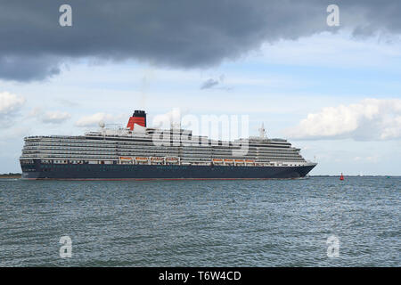 The Giant, Cunard Line, MS QUEEN VICTORIA, Entering The Deep Water Channel, As She Sails Out Of Southampton, UK, For Hamburg Germany. 28 April 2019. - Stock Photo