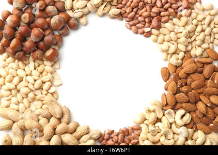 Frame made of different nuts on white background - Stock Photo