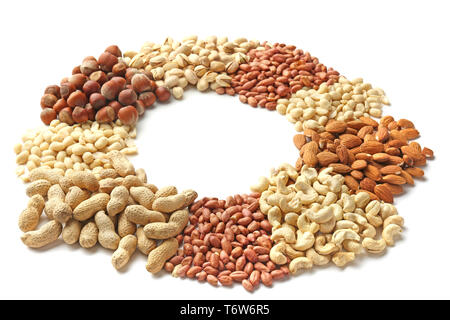 Frame made of different types of nuts on white background - Stock Photo