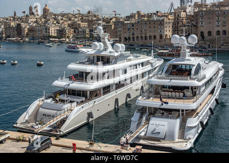 The 212 ft luxury super yacht Sea Rhapsody, and 240 ft Plan B, berthed in Dockyard Creek in Valletta's Grand Harbour. - Stock Photo