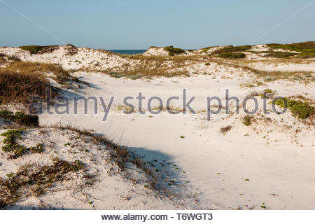 Looking out over the white sand dunes along the gulf shore at Topsail Hill Preserve State Park, Santa Rosa Beach, Florida in mid-April - Stock Photo