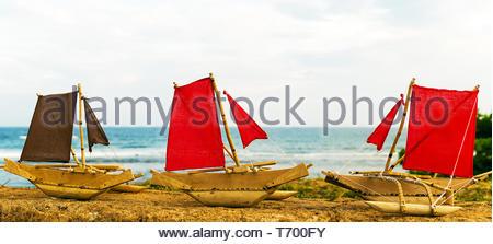 Square red sail fishing boat Sailboat - Stock Photo