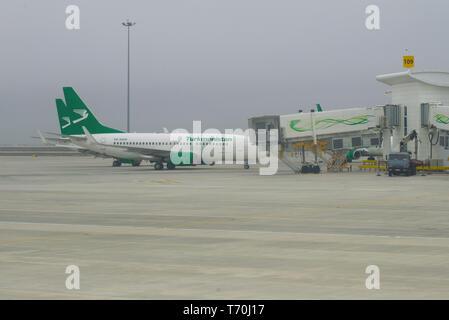ASHGABAT, TURKMENISTAN - JANUARY 05, 2019: Foggy winter day of the Ashgabat international airport - Stock Photo