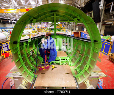 FILE PHOTO - Bombardier aircraft electricians work on Learjet 40 XR aircraft on the production line in Belfast, Northern Ireland, on Monday, Jan. 21, 2008. Almost 1,000 jobs are to go at Bombardier Aerospace factories in Northern Ireland, Thursday, April 2, 2009. A total of 975 staff are losing their jobs, with 310 permanent staff and all 665 agency staff being made redundant. A company statement said it was cutting aircraft production rates and reducing manpower at all its sites because of an 'unprecedented recession'.  Paul McErlane Photography - Stock Photo
