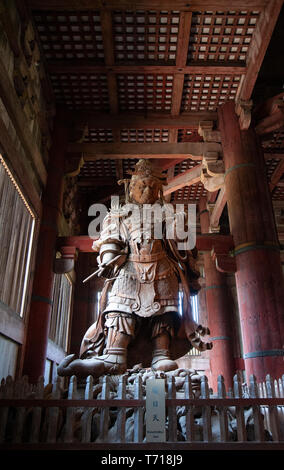 Wooden statue of Komokuten, one of a pair of Celestrial Guardians in the Daibutsuden or Great Buddha Hall, Todaiji Tempe in Nara, Japan - Stock Photo