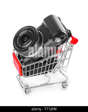 Photo camera in shopping cart - Stock Photo