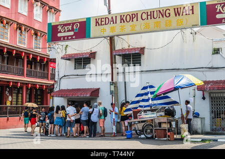 Malacca,Malaysia - June 21, 2019 : Jonker Street is the centre street of Chinatown in Malacca. People can seen queuing outside the restaurant during l - Stock Photo
