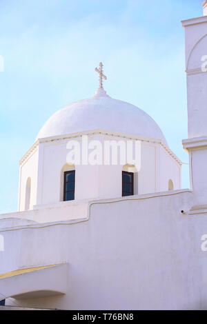 Greek orthodox church white dome against blue sky, Megalohori, Santorini, Greece - Stock Photo